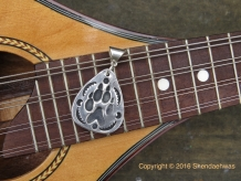 Fine silver wolf paw in guitar pick shape by Shendaehwas.