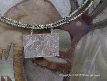 Records of the past, reproductions of Southwestern rock arts, pendant by Shendaehwas